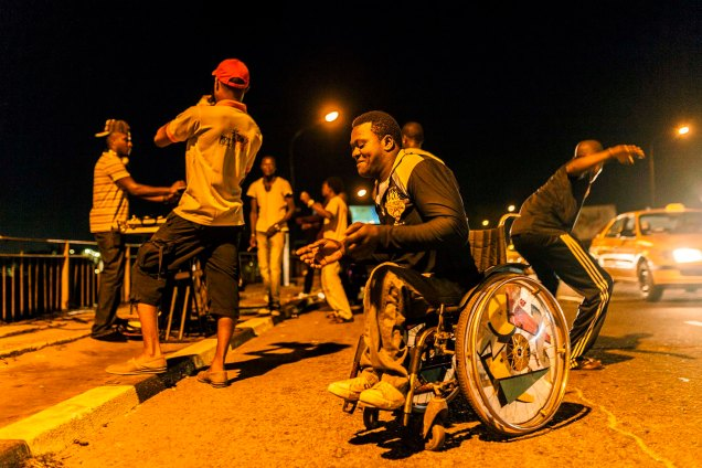 Andrew Esiebo, Street party at on the Onika-Victoria Island link bridge link with Dj Ola disc jockeying in Lagos.