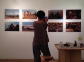 Gallery owner Hideko Saito photographing Yvon Ngassam's work after exhibition hanging. Image: YaPhoto.