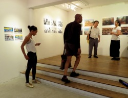 Left: two local artists visiting YaPhoto@Arakawa Africa exhibition. Image: YaPhoto.